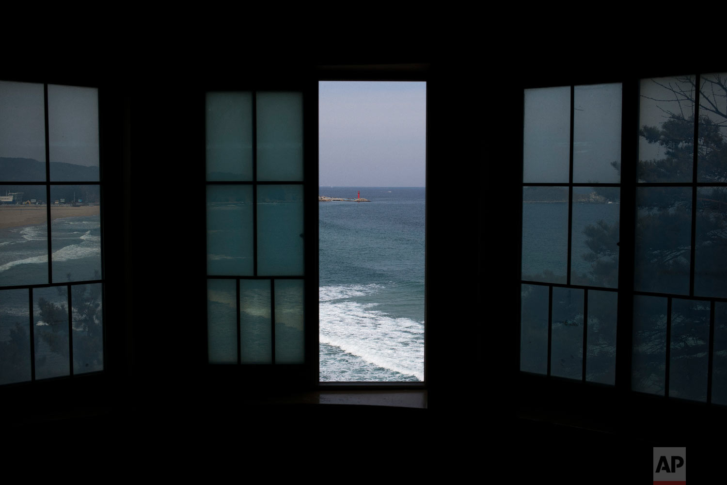A window is left open in a room overlooking Hwajinpo Beach at the villa known as Hwajinpo Castle, once a holiday home for late North Korea founder Kim Il Sung, at Hwajinpo Beach, South Korea, Monday, Feb. 19, 2018. (AP Photo/Jae C. Hong)