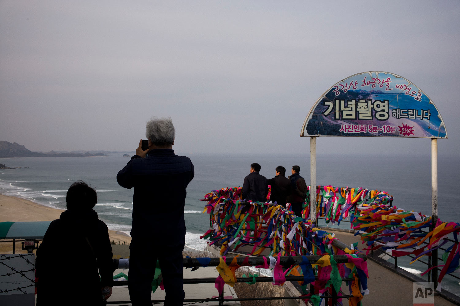 People view North Korea from the Goseong Unification Observatory in Goseong, South Korea, Monday, Feb. 19, 2018. (AP Photo/Jae C. Hong)