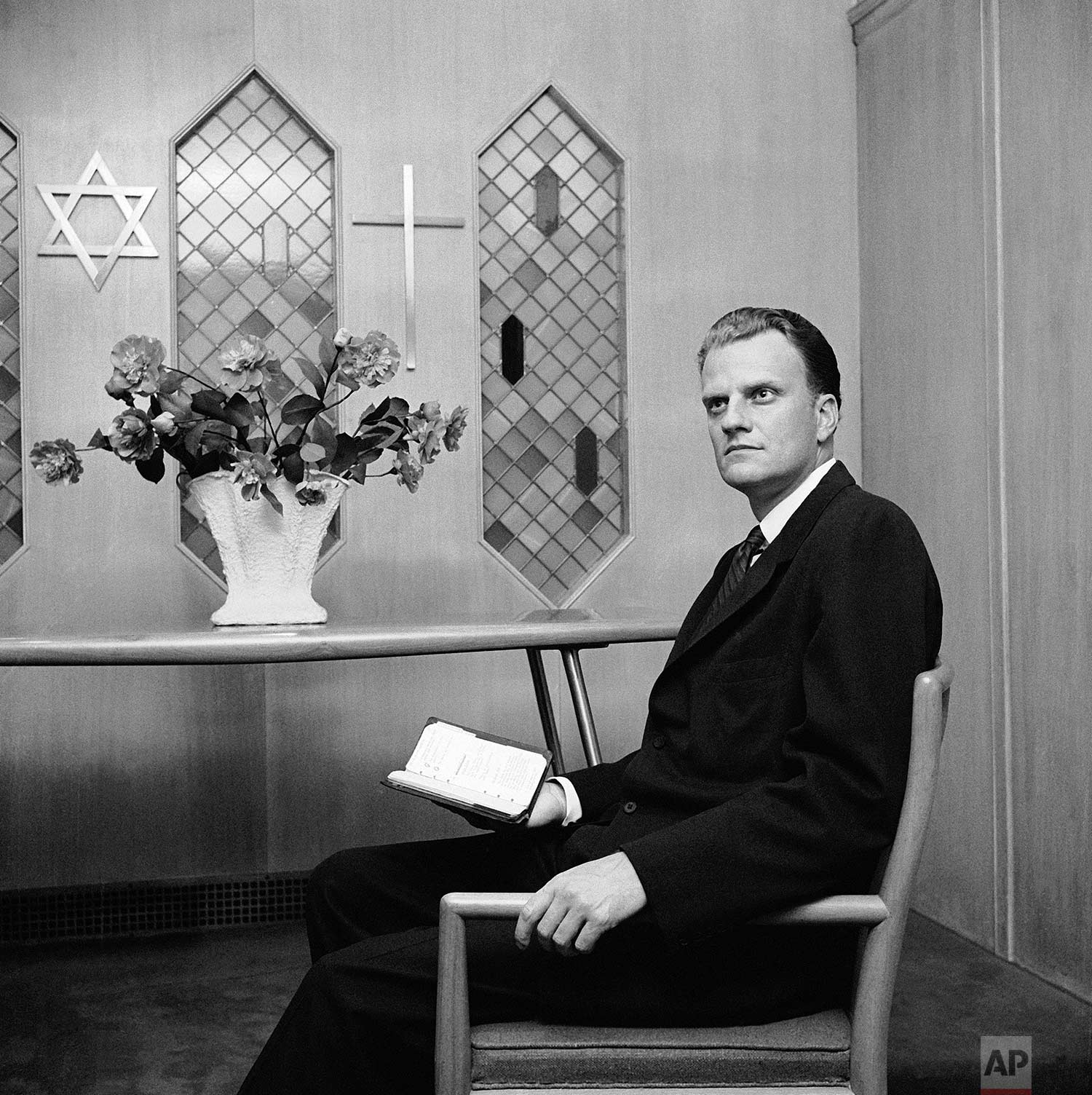 Evangelist Billy Graham shown in meditation, October 25, 1957 in the chapel in the New York Hotel for Guidance. (AP Photo/Harvey Lippman)