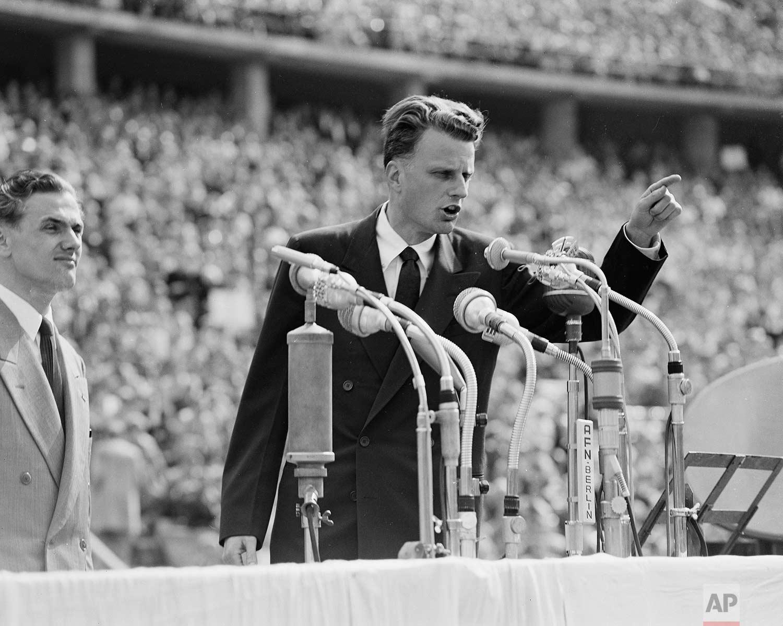 American evangelist Billy Graham speaks to over 100,000 Berliners at the Olympic Stadium in Germany, June 27, 1954. (AP Photo)