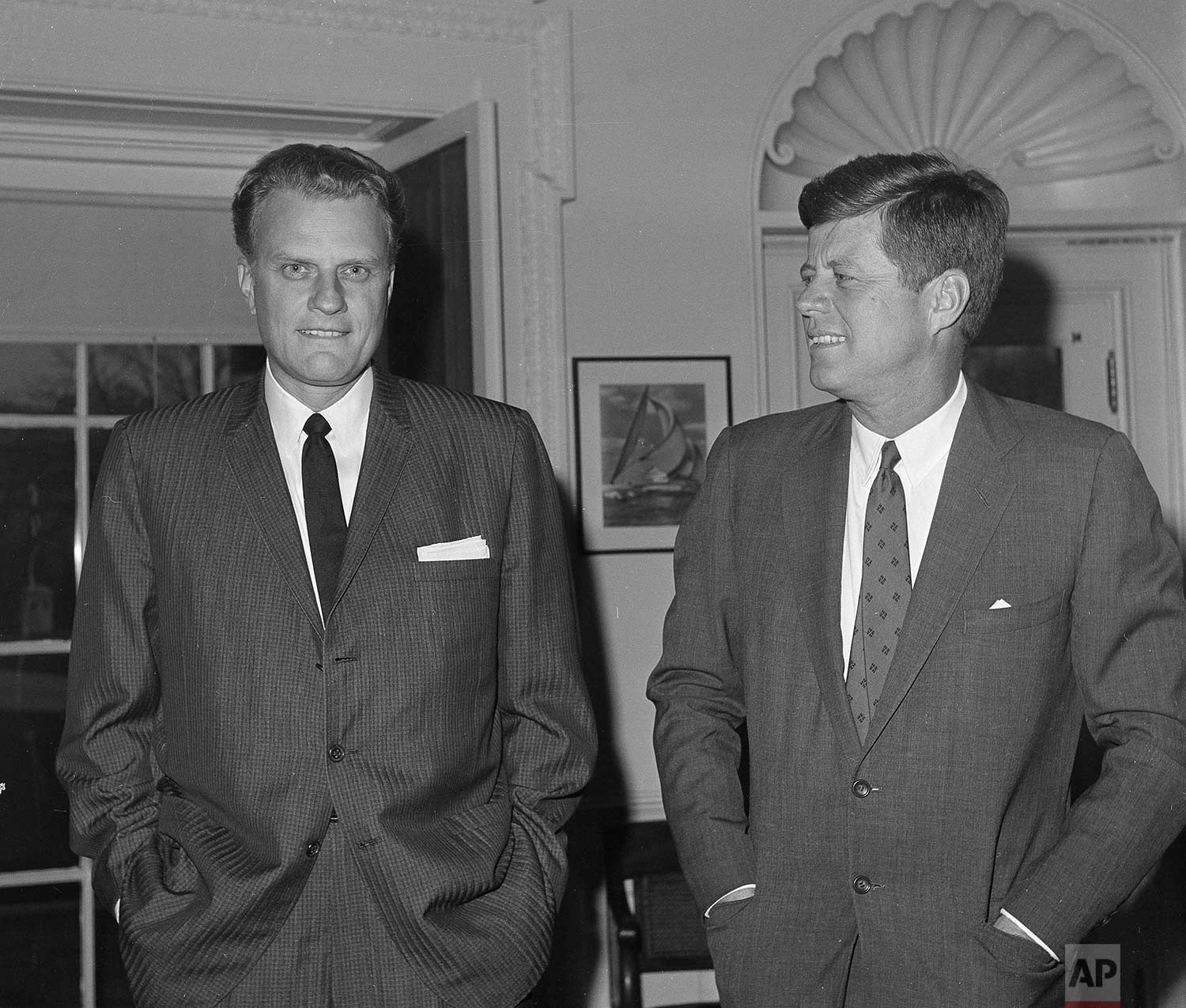 Evangelist Billy Graham, left, talks with President John F. Kennedy during a call at the President's White House office, Dec. 12, 1961.(AP Photo)