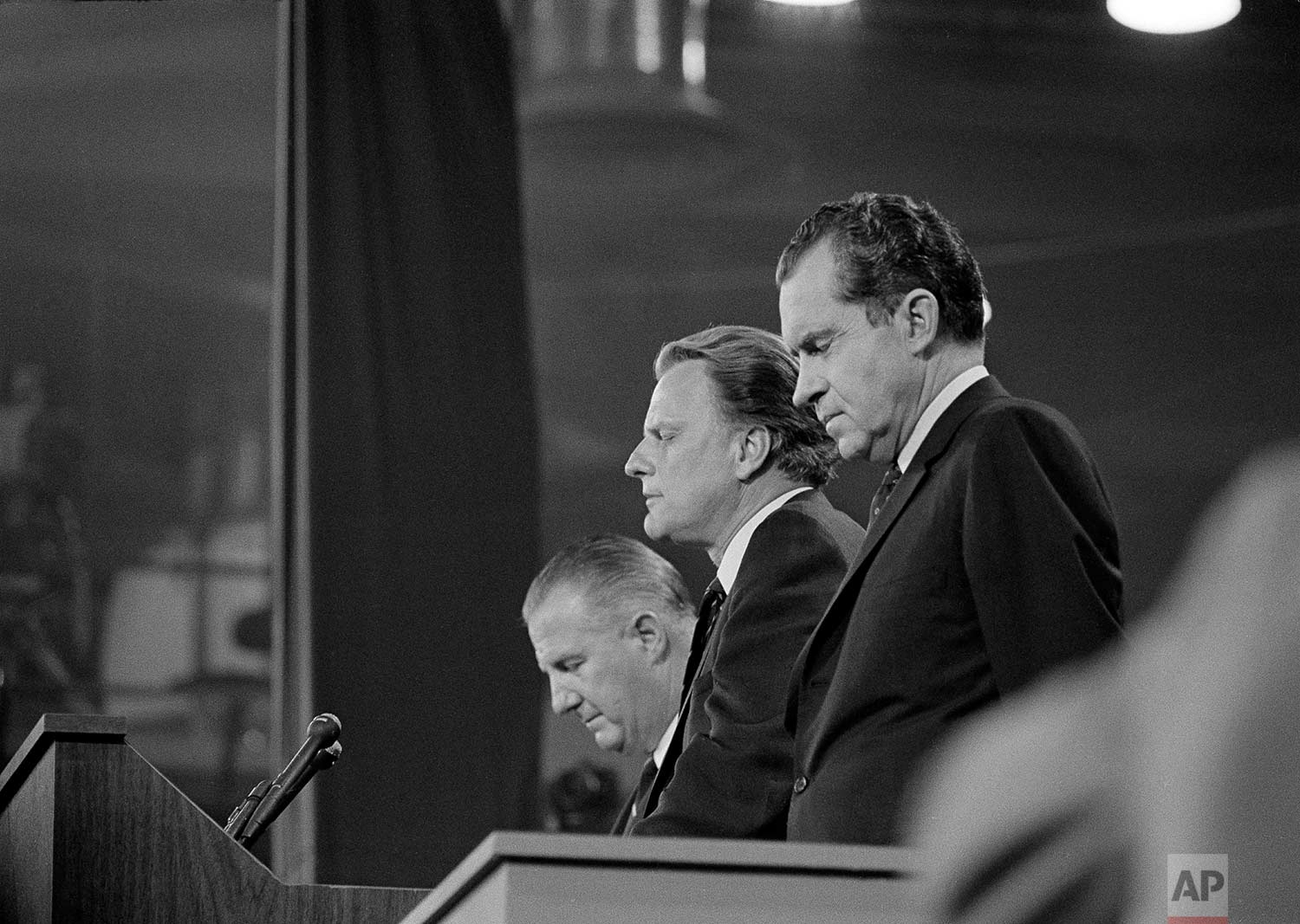 Dr. Billy Graham gives the closing benediction at wind-up session of the Republican National Convention in Miami, Fla., Aug. 8, 1968. Left to right is Maryland Gov. Spiro T. Agnew, Graham and Richard M. Nixon. (AP Photo)