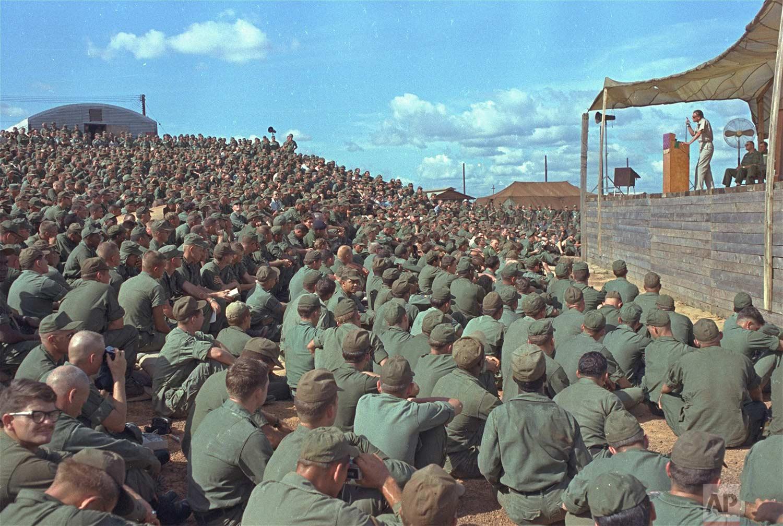 Evangelist Billy Graham speaks a crowd of more than 5,000 U.S. troops at Long Binh, Vietnam, December 23, 1966. (AP Photo)