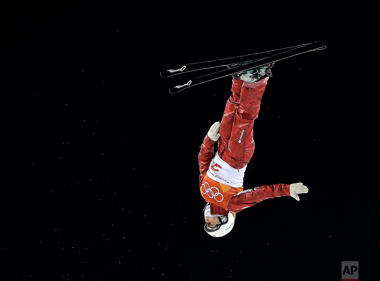 Russian athlete KristinaSpiridonova jumps during the women's freestyle aerial final at Phoenix Snow Park at the 2018 Winter Olympics in Pyeongchang, South Korea, Friday, Feb. 16, 2018. (AP Photo/Gregory Bull)
