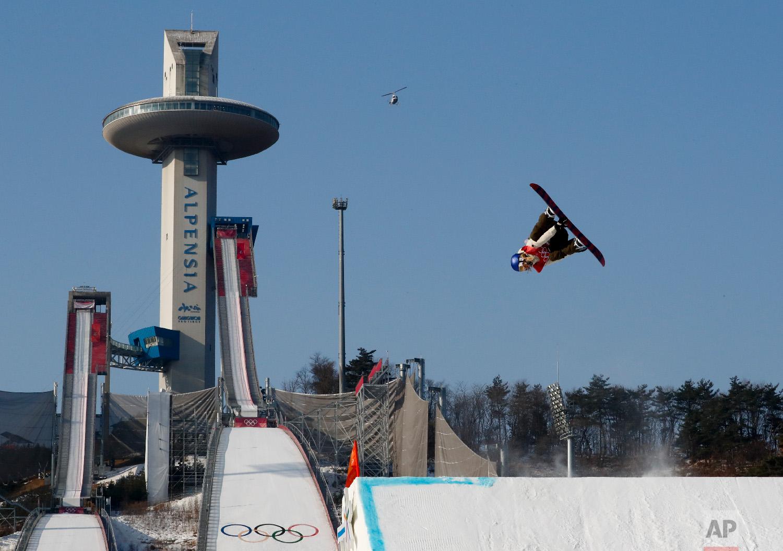 Anna Gasser, of Austria, jumps during the women's Big Air snowboard final at the 2018 Winter Olympics in Pyeongchang, South Korea, Thursday, Feb. 22, 2018. (AP Photo/Matthias Schrader)