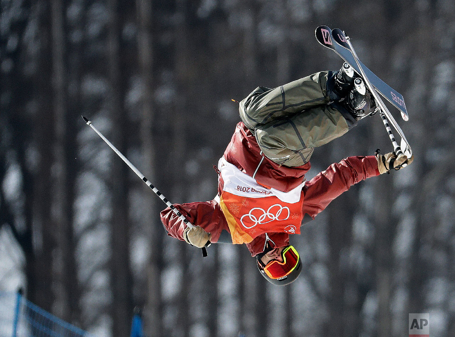 NoahBowman, of Canada, jumps during the men's halfpipe final at Phoenix Snow Park at the 2018 Winter Olympics in Pyeongchang, South Korea, Thursday, Feb. 22, 2018. (AP Photo/Lee Jin-man)