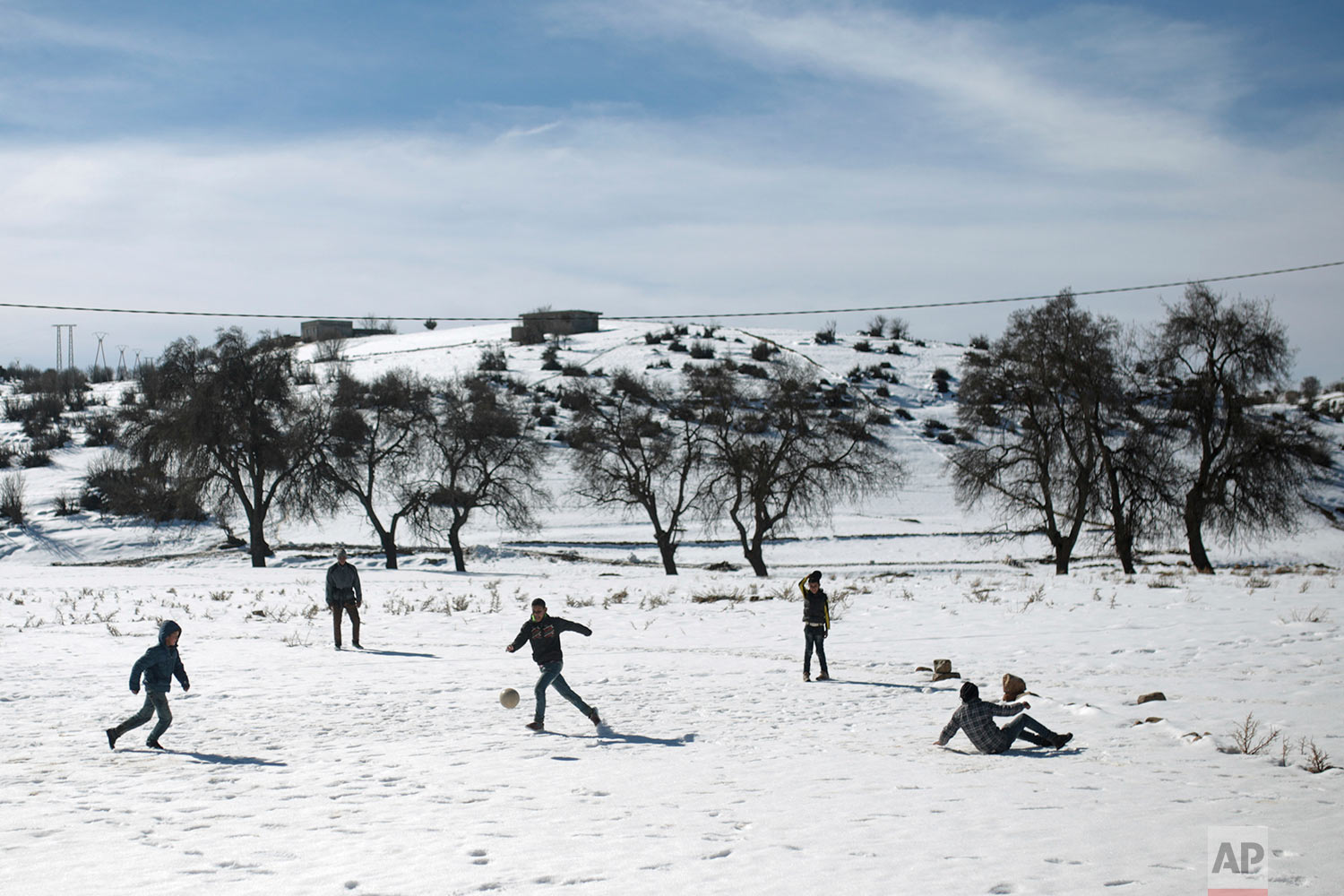 In this Thursday, Feb. 15, 2018, children play soccer in the snow in Tighanmin, a Middle Atlas village near Azilal, central Morocco. (AP Photo/Mosa'ab Elshamy)
