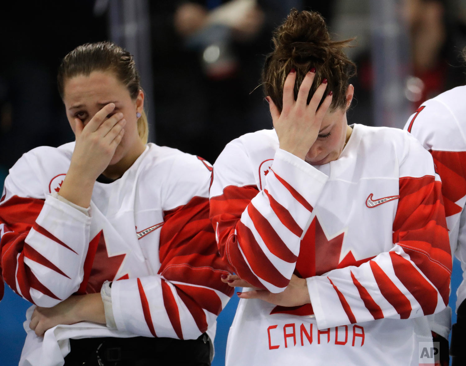Canada players react after the women's gold medal hockey game.