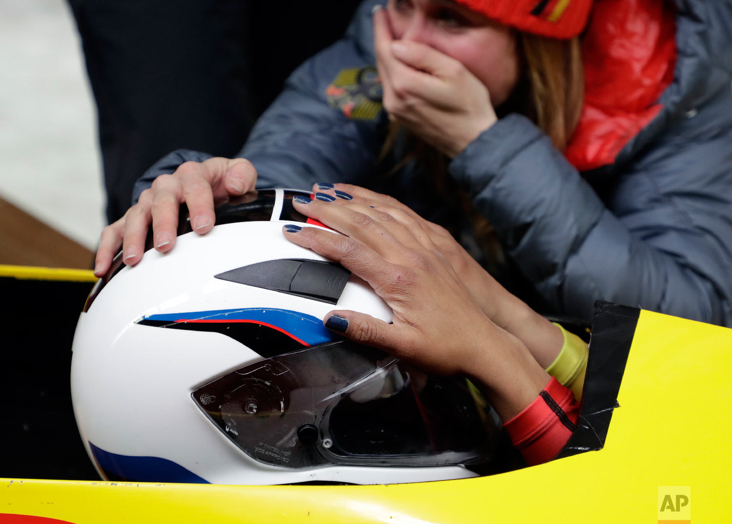 Driver Mariama Jamanka of Germany celebrates with teammates after their gold medal winning run during the women's two-man bobsled final at the 2018 Winter Olympics in Pyeongchang, South Korea, Wednesday, Feb. 21, 2018. (AP Photo/Michael Sohn)