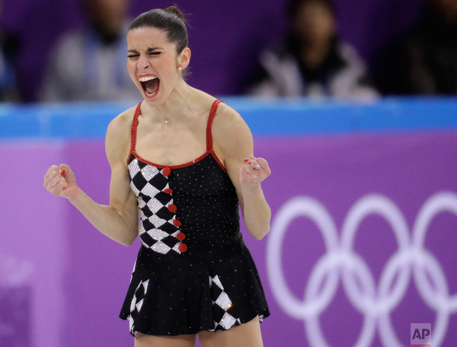 Valentina Marchei of Italy reacts after her and her partner Ondrej Hotarek's performance in the team event pair skating in the Gangneung Ice Arena at the 2018 Winter Olympics in Gangneung, South Korea, Sunday, Feb. 11, 2018. (AP Photo/Bernat Armangue)