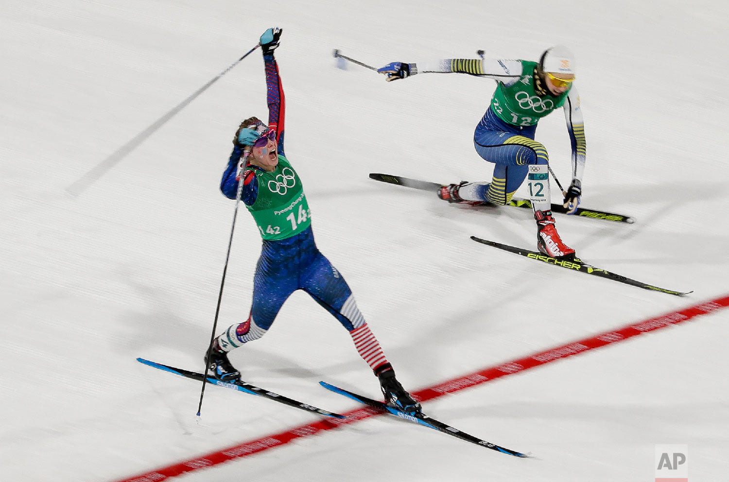 Jessica Diggins, left, of the United States, celebrates after winning the gold medal.