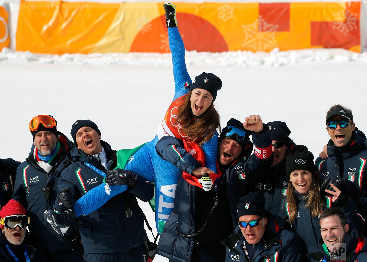 Gold medal winner Sofia Goggia, of Italy, celebrates after the flower ceremony for the women's downhill at the 2018 Winter Olympics in Jeongseon, South Korea, Wednesday, Feb. 21, 2018. (AP Photo/Christophe Ena)