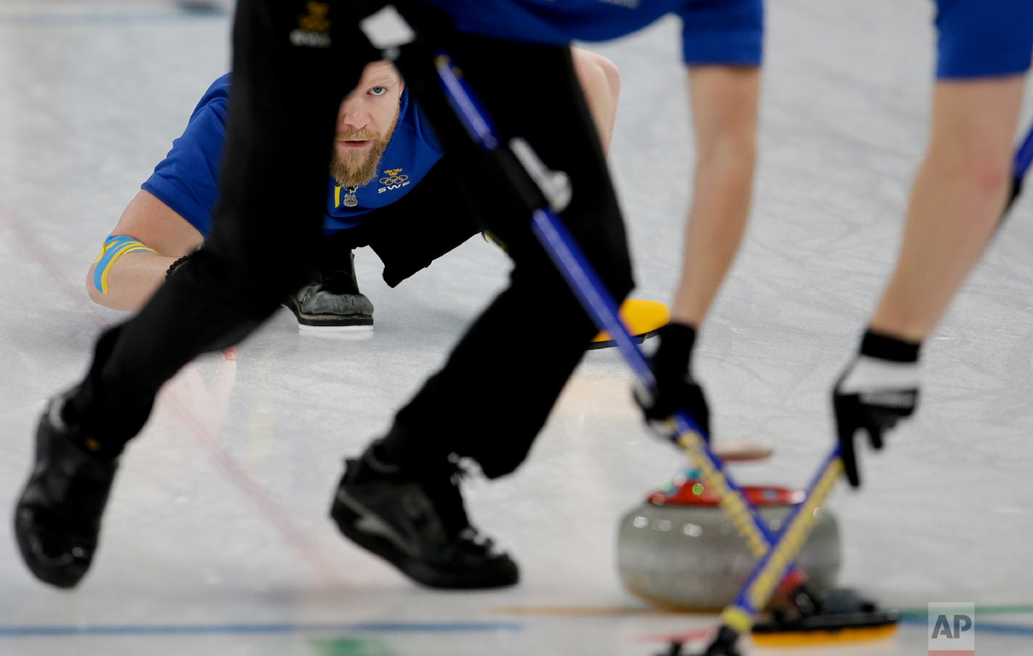 Sweden's skip Niklas Edin watches his teammates sweep the ice during the men's final curling match against United States at the 2018 Winter Olympics in Gangneung, South Korea, Saturday, Feb. 24, 2018. (AP Photo/Natacha Pisarenko)