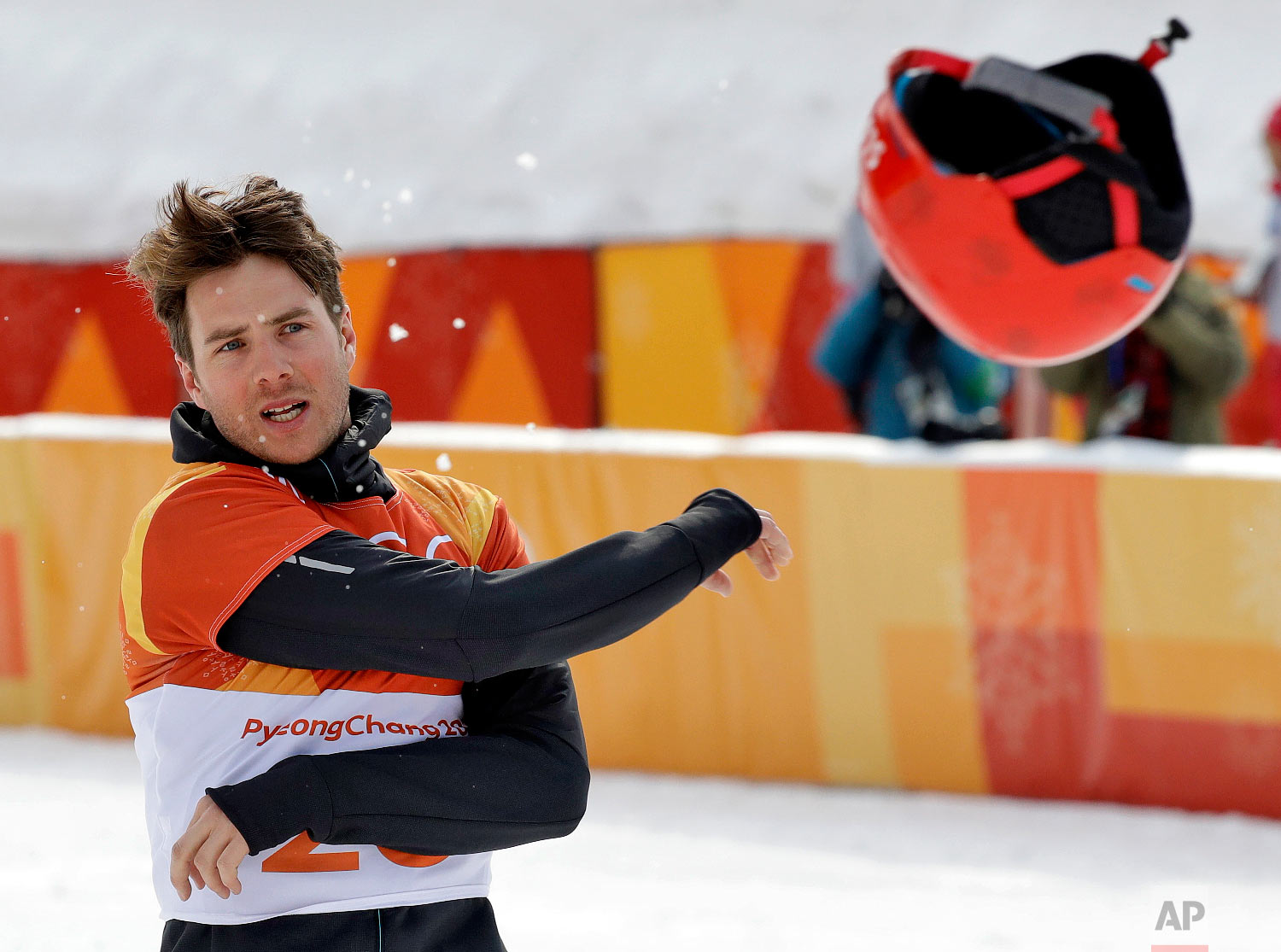 Bronze medal winner Zan Kosir, of Slovenia, tosses his helmet after the men's parallel giant slalom small final at Phoenix Snow Park at the 2018 Winter Olympics in Pyeongchang, South Korea, Saturday, Feb. 24, 2018. (AP Photo/Kin Cheung)