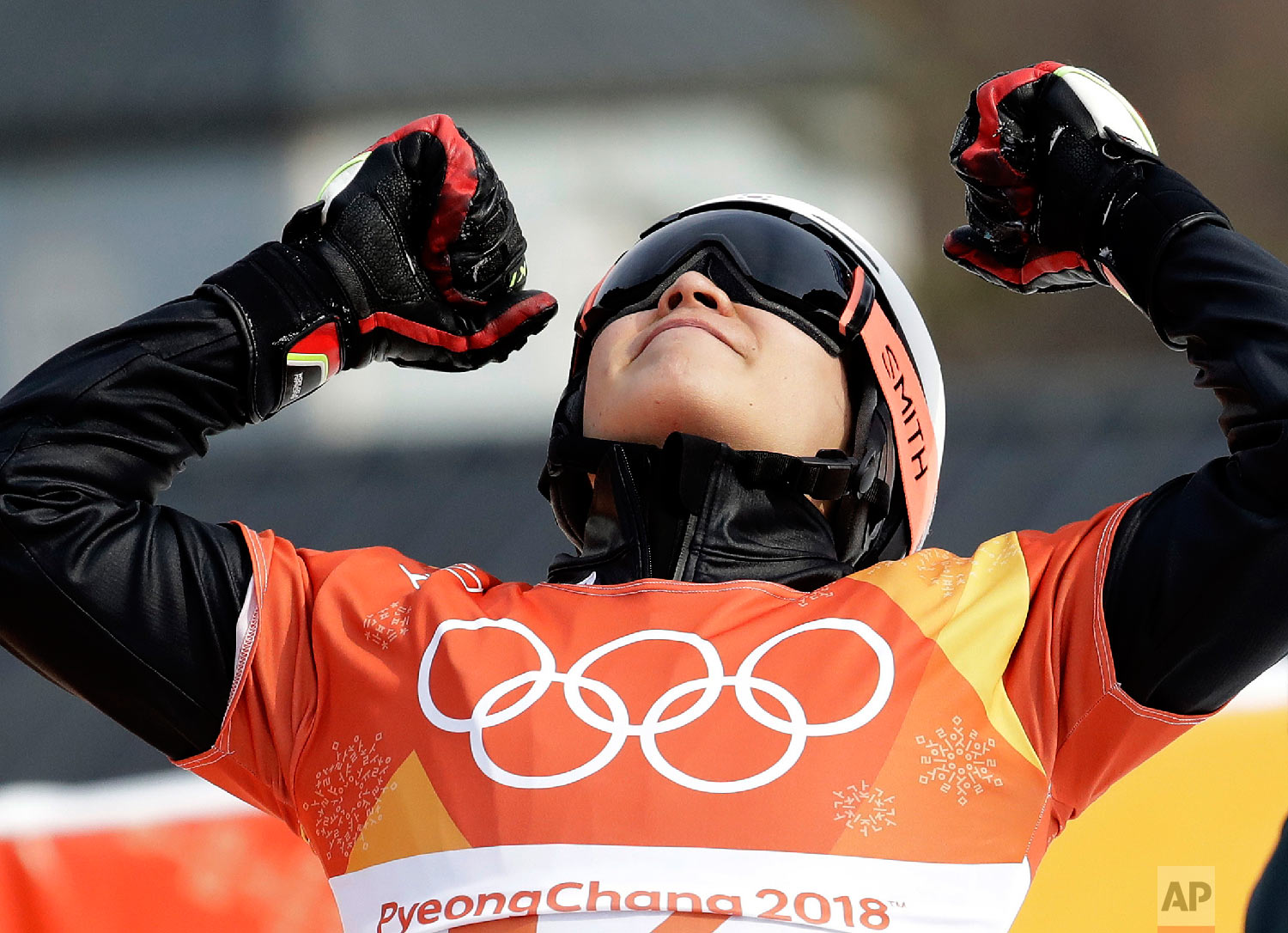Silver medal winner Lee Sangho, of South Korea, celebrates after winning semifinal during the men's parallel giant slalom semifinal at Phoenix Snow Park at the 2018 Winter Olympics in Pyeongchang, South Korea, Saturday, Feb. 24, 2018. (AP Photo/Lee Jin-man)