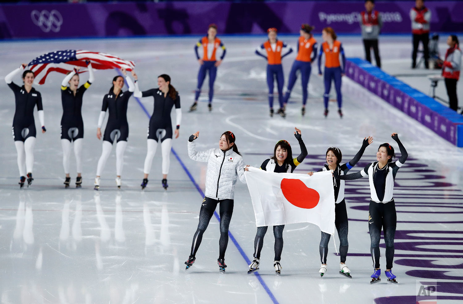 Gold medalist team Japan, front, and bronze medalist team U.S.A. celebrate, while silver medalist team Netherlands appears dejected after the women's team pursuit speedskating race at the Gangneung Oval at the 2018 Winter Olympics in Gangneung, South Korea, Wednesday, Feb. 21, 2018. (AP Photo/Vadim Ghirda)