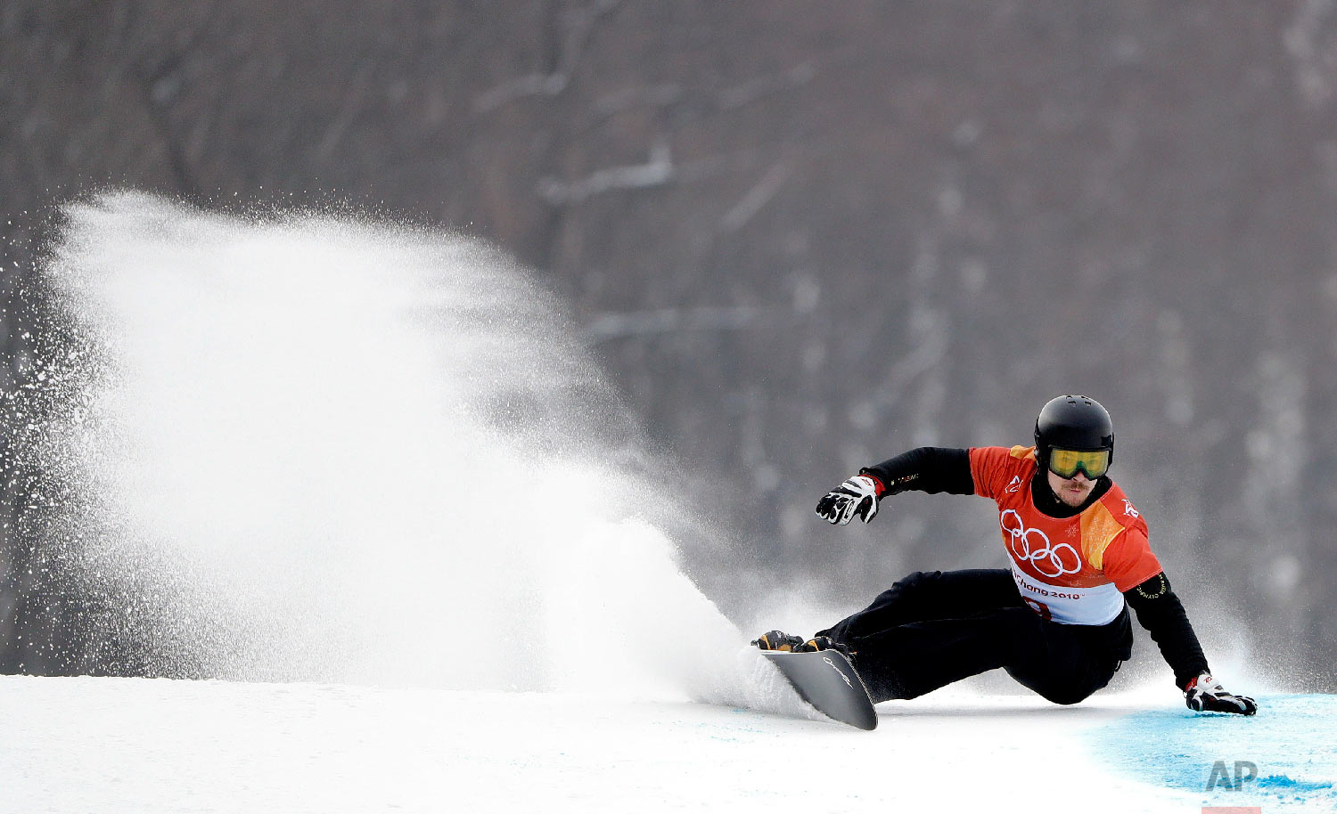 Russian athlete Vic Wild runs the course during the men's parallel giant slalom qualification run at Phoenix Snow Park at the 2018 Winter Olympics in Pyeongchang, South Korea, Saturday, Feb. 24, 2018. (AP Photo/Gregory Bull)