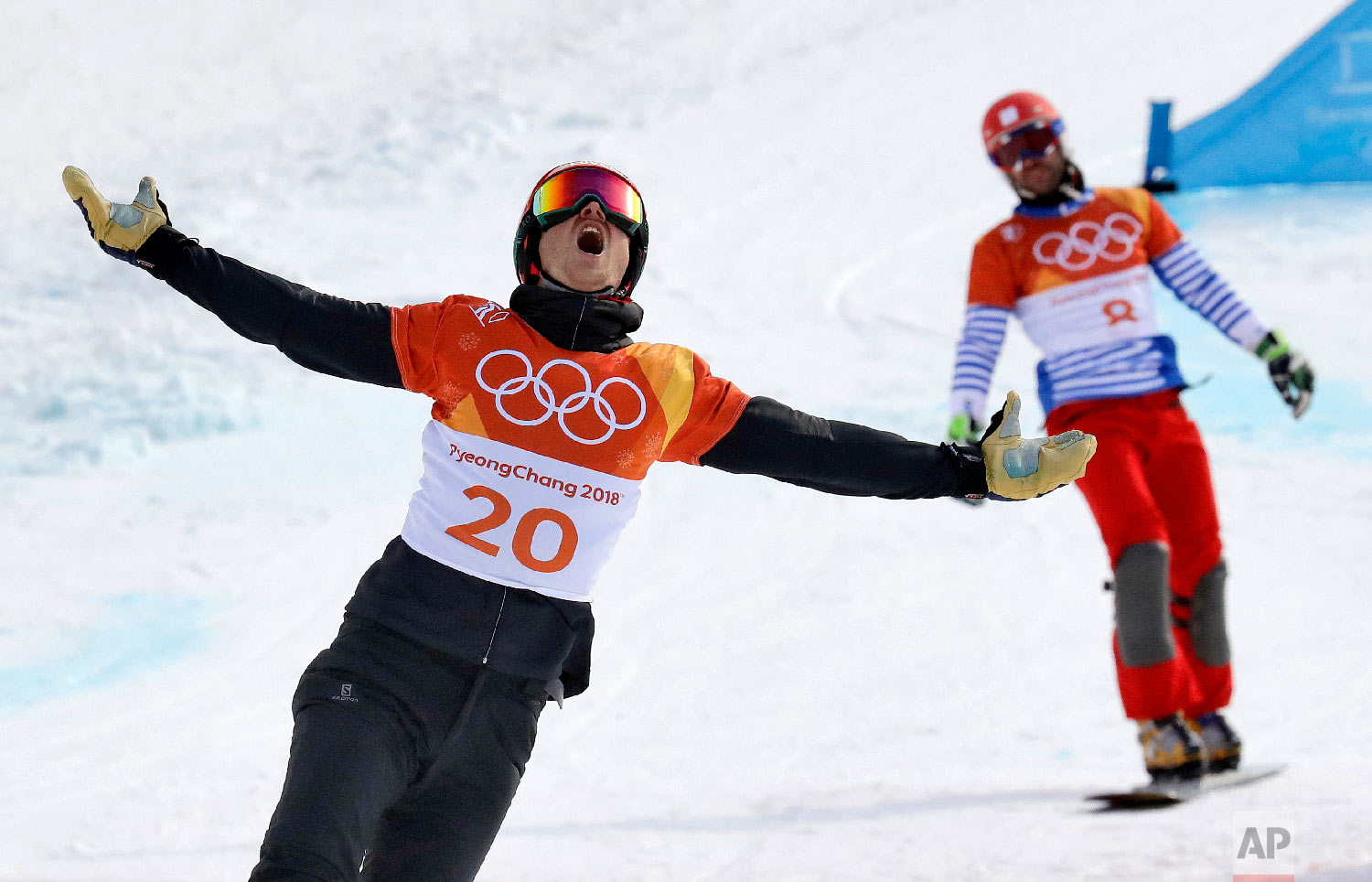 Bronze medal winner Zan Kosir, of Slovenia, celebrates after the small men's parallel giant slalom final at Phoenix Snow Park at the 2018 Winter Olympics in Pyeongchang, South Korea, Saturday, Feb. 24, 2018. (AP Photo/Lee Jin-man)