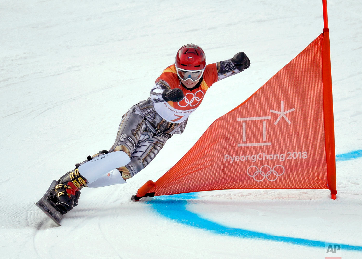 Ester Ledecka, of the Czech Republic, runs the course during the women's parallel giant slalom qualification run at Phoenix Snow Park at the 2018 Winter Olympics in Pyeongchang, South Korea, Saturday, Feb. 24, 2018. (AP Photo/Kin Cheung)
