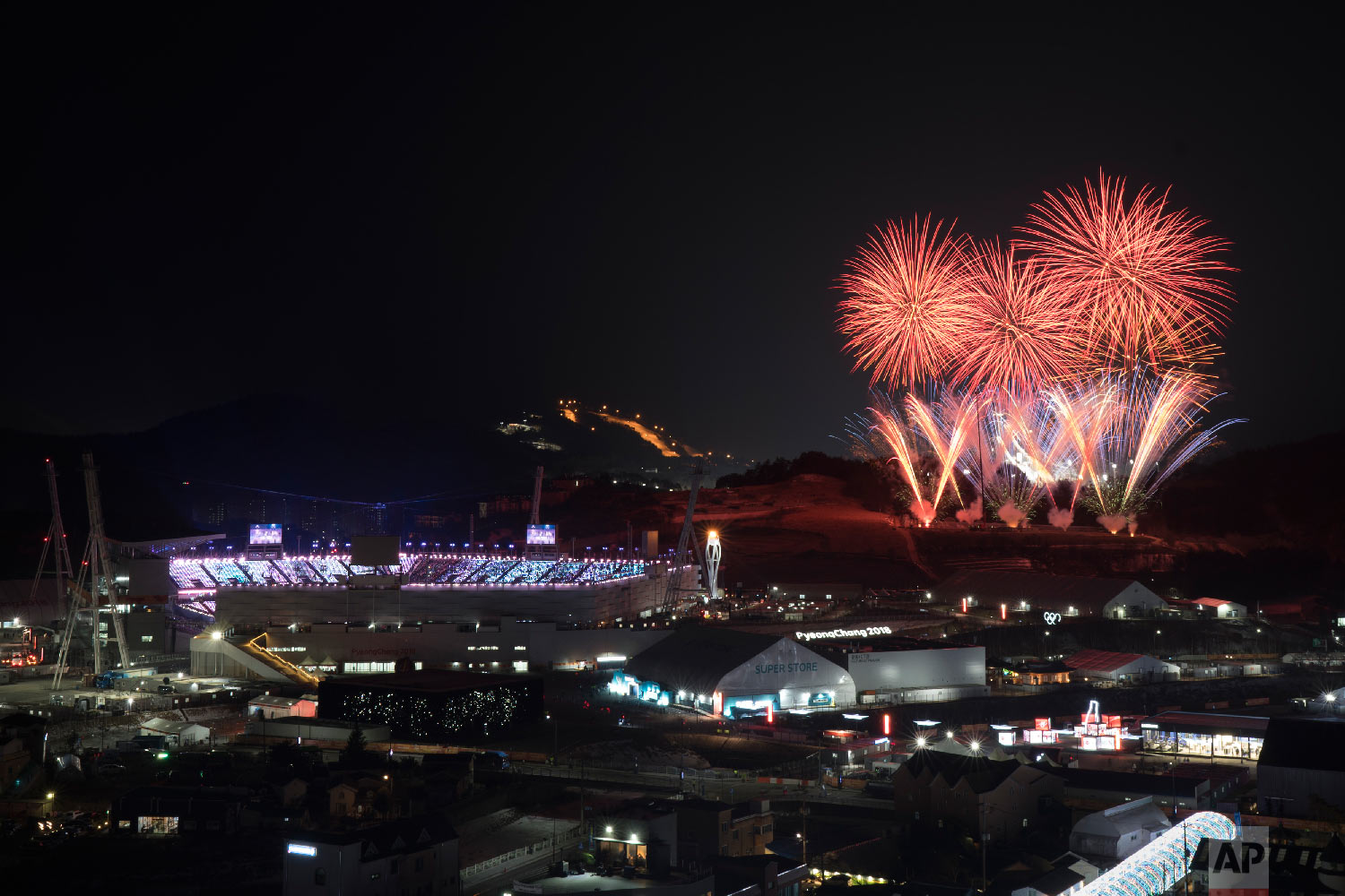 Fireworks explode behind the Olympic Stadium during the closing ceremony of the 2018 Winter Olympics in Pyeongchang, South Korea, Sunday, Feb. 25, 2018. (AP Photo/Felipe Dana)