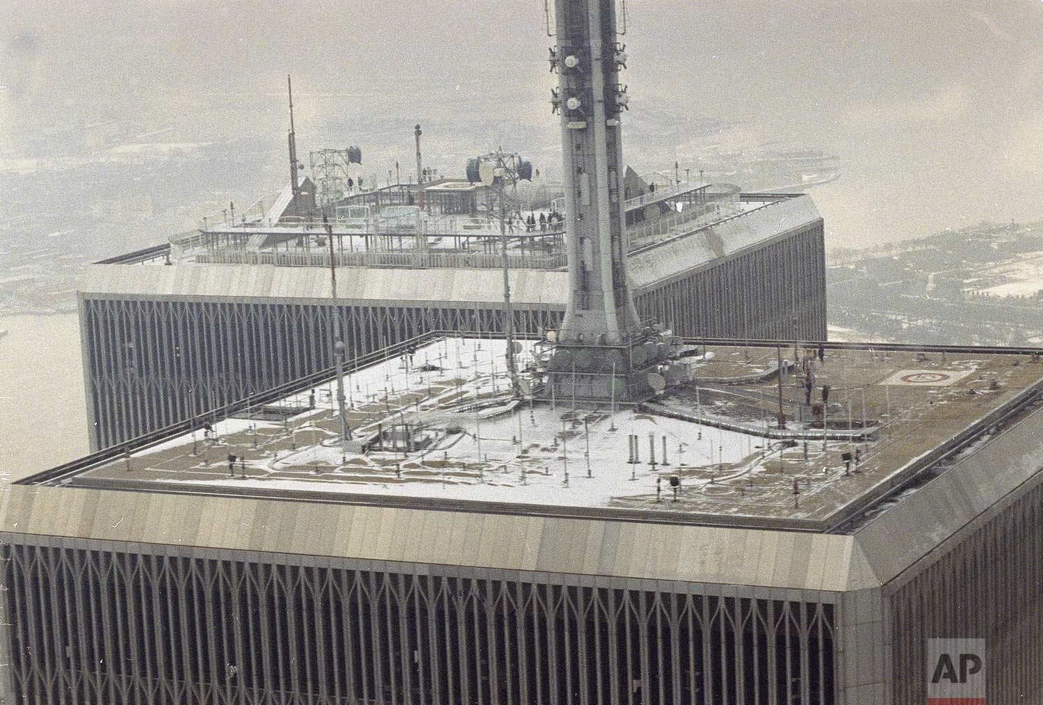 People line the roof of the World Trade Center in New York following an underground explosion which ripped through a garage at the twin towers complex, Feb. 26, 1993. (AP Photo/Val Mazzucca)