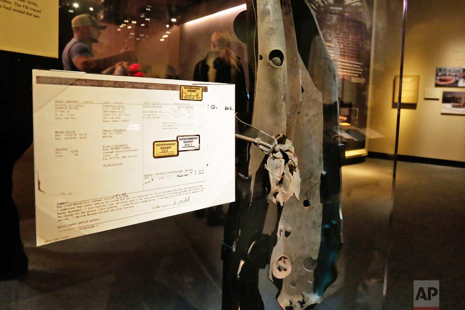 A piece of the rented van, and rental agreement, that began leading investigators to Muslim extremists who sought to punish the United States for its Middle East policies, according to prosecutors, in the Feb. 26, 1993 attack at the World Trade Center, are displayed at the National September 11 Museum, in New York, Friday, Feb. 23, 2018. It was a terror attack that foreshadowed Sept. 11: the deadly World Trade Center bombing that happened 25 years ago Monday. (AP Photo/Richard Drew)