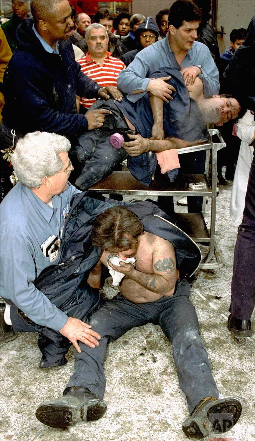 In this Feb. 26, 1993 photo, victims of a truck bombing at the World Trade Center in New York are treated at the scene. (AP Photo/Marty Lederhandler)