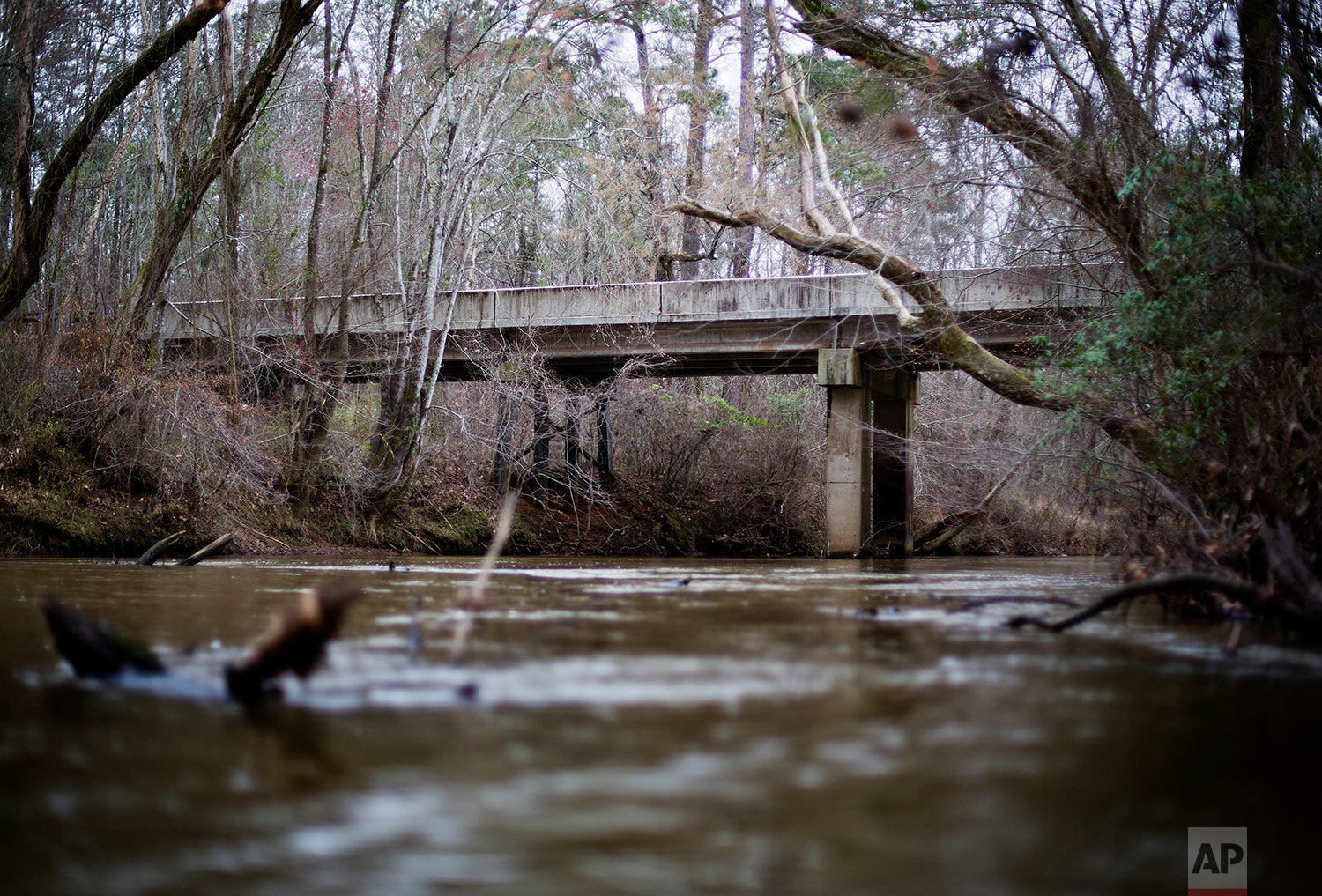 This Feb. 22, 2018 photo shows a bridge that spans the Apalachee River at Moore's Ford Road where in 1946 two young black couples were stopped by a white mob who dragged them to the riverbank and shot them multiple times in Monroe, Ga. (AP Photo/David Goldman)