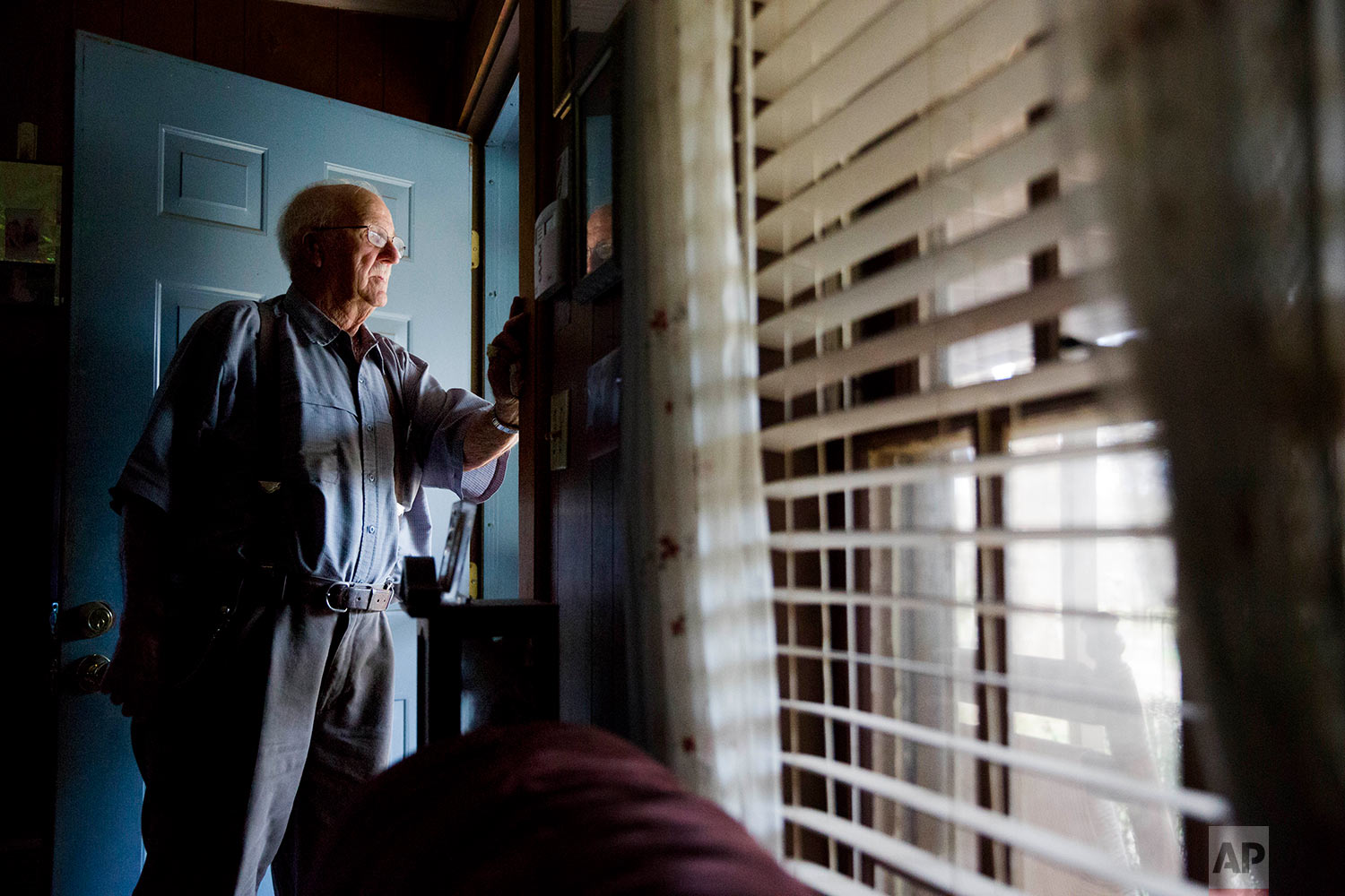 Clinton Adams, believed to be the only living witness to the 1946 lynching of two black couples by a white mob, stands for a portrait in his home in Winder, Ga., Thursday, Feb. 22, 2018. (AP Photo/David Goldman)