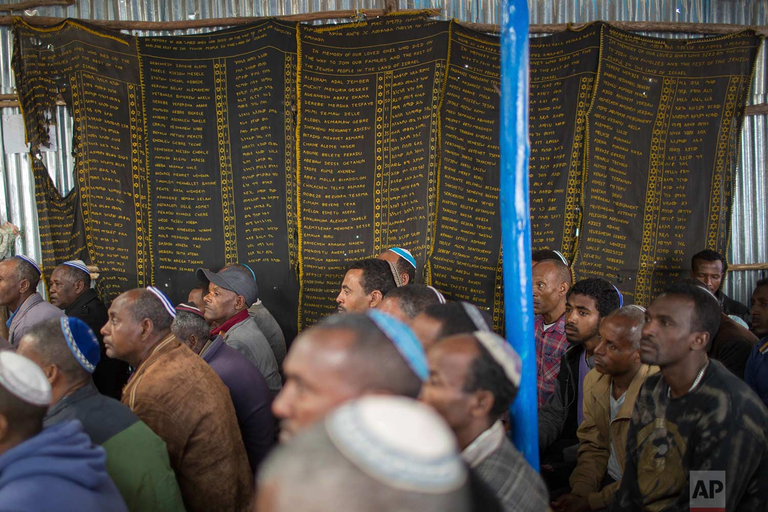 Members of Ethiopia's Jewish community attend a solidarity event for their relatives in Israel, at the synagogue in Addis Ababa, Ethiopia Wednesday, Feb. 28, 2018. (AP Photo/Mulugeta Ayene)