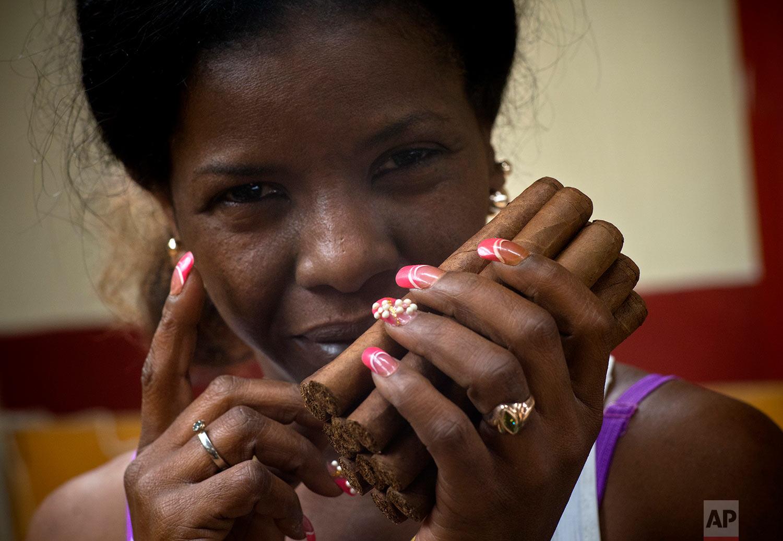In this March 1, 2018 photo, Milagros Suarez Tamayo poses for a photo at La Corona cigar factory in Havana, Cuba. (AP Photo/Ramon Espinosa)