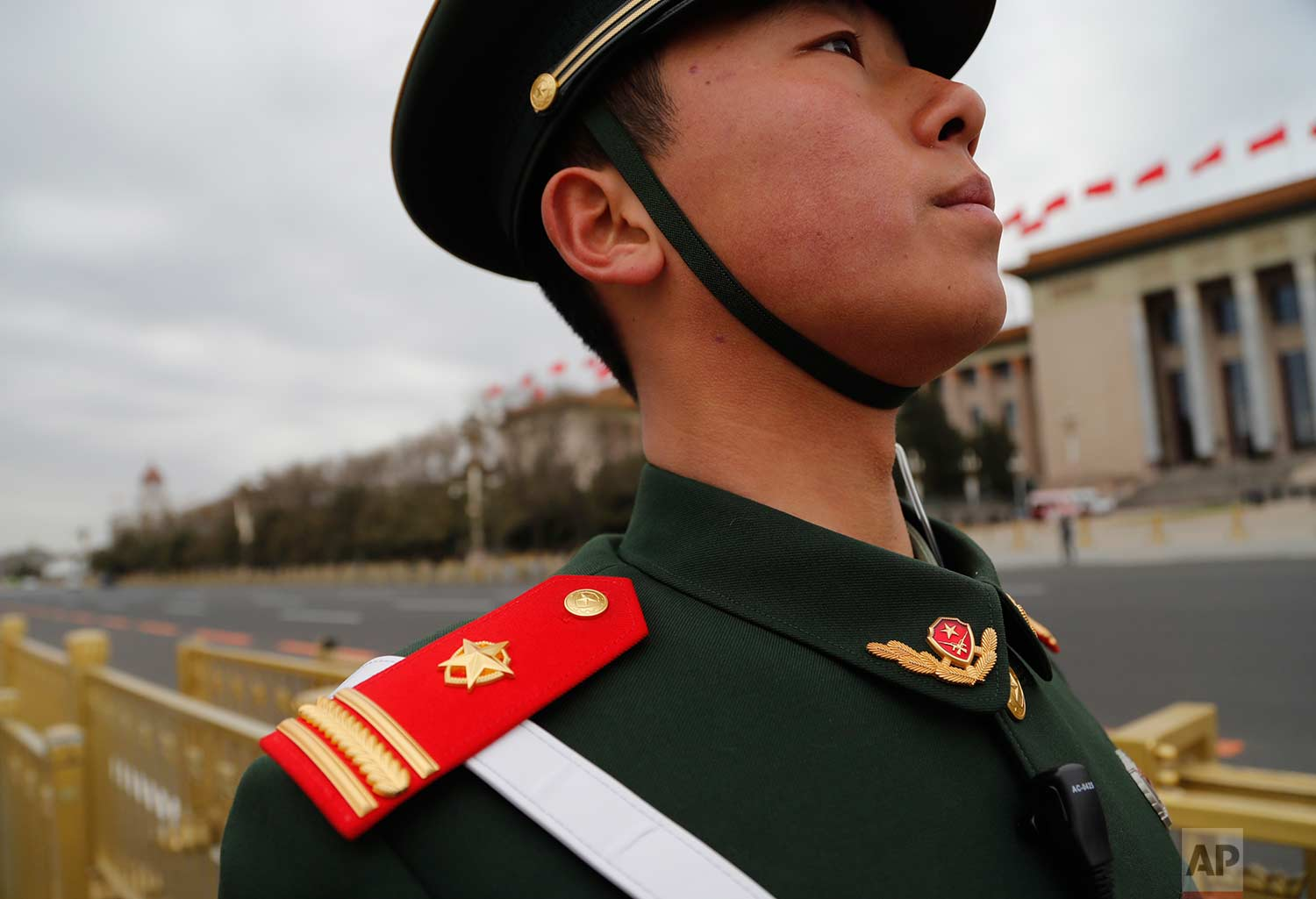 In this Thursday, March 15, 2018 photo, a Chinese paramilitary policeman wears a red epaulette on his shoulder as he stands guard during the closing session of the Chinese People's Political Consultative Conference (CPPCC) at the Great Hall of the People in Beijing. (AP Photo/Aijaz Rahi)