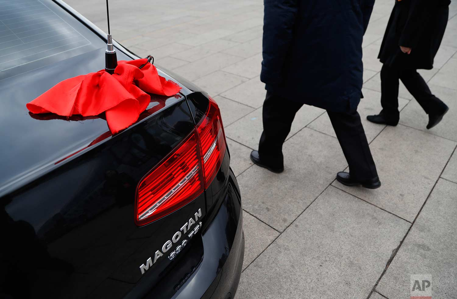 In this Thursday, March 15, 2018 photo, red ribbon is tied to an antenna of an escort car parked outside The Great Hall of People during the closing session of the Chinese People's Political Consultative Conference (CPPCC) at the Great Hall of the People in Beijing. (AP Photo/Aijaz Rahi)