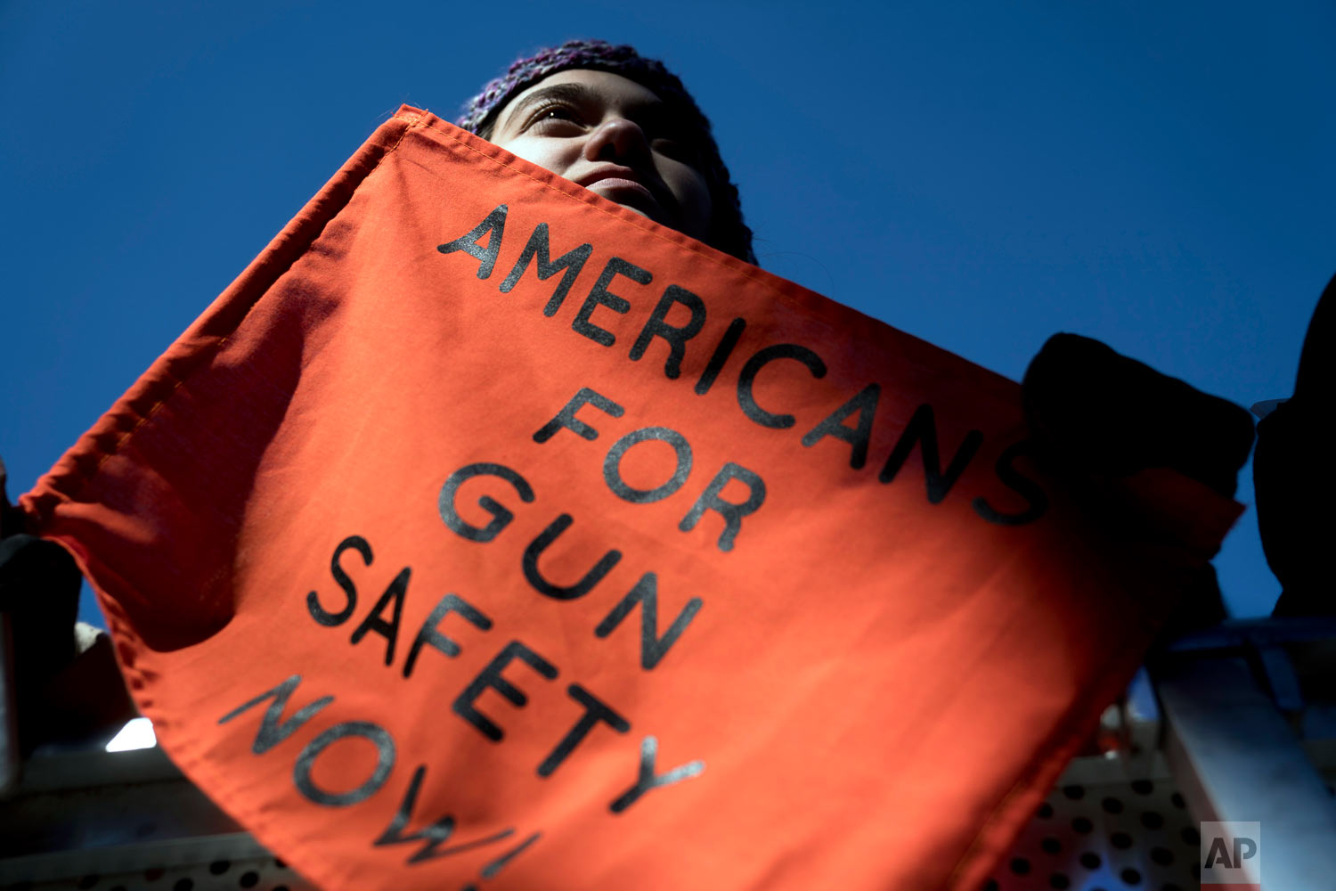 """Isabel White of Parkland, Fla., holds a sign that reads """"Americans for Gun Safety Now!"""" during the """"March for Our Lives"""" rally in support of gun control in Washington, Saturday, March 24, 2018. (AP Photo/Andrew Harnik)"""