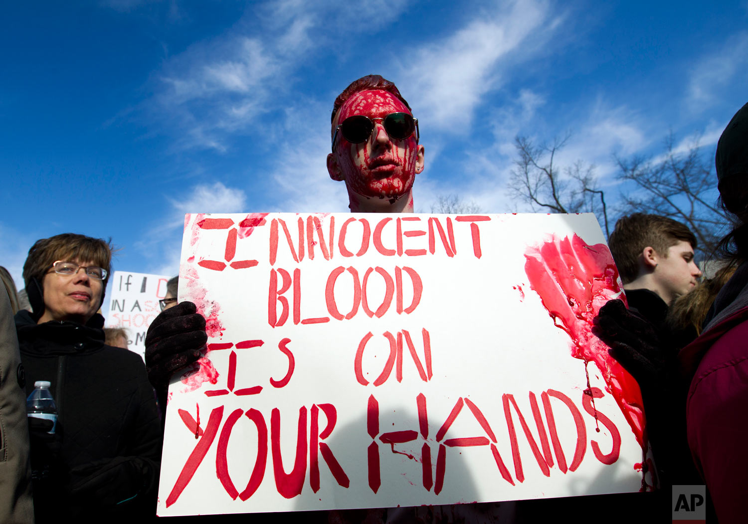 """Connor Feliu of Syracuse N.Y., covered in red paint, attends the """"March for Our Lives"""" rally in support of gun control in Washington, Saturday, March 24, 2018, on Pennsylvania Avenue near the U.S. Capitol. (AP Photo/Jose Luis Magana)"""