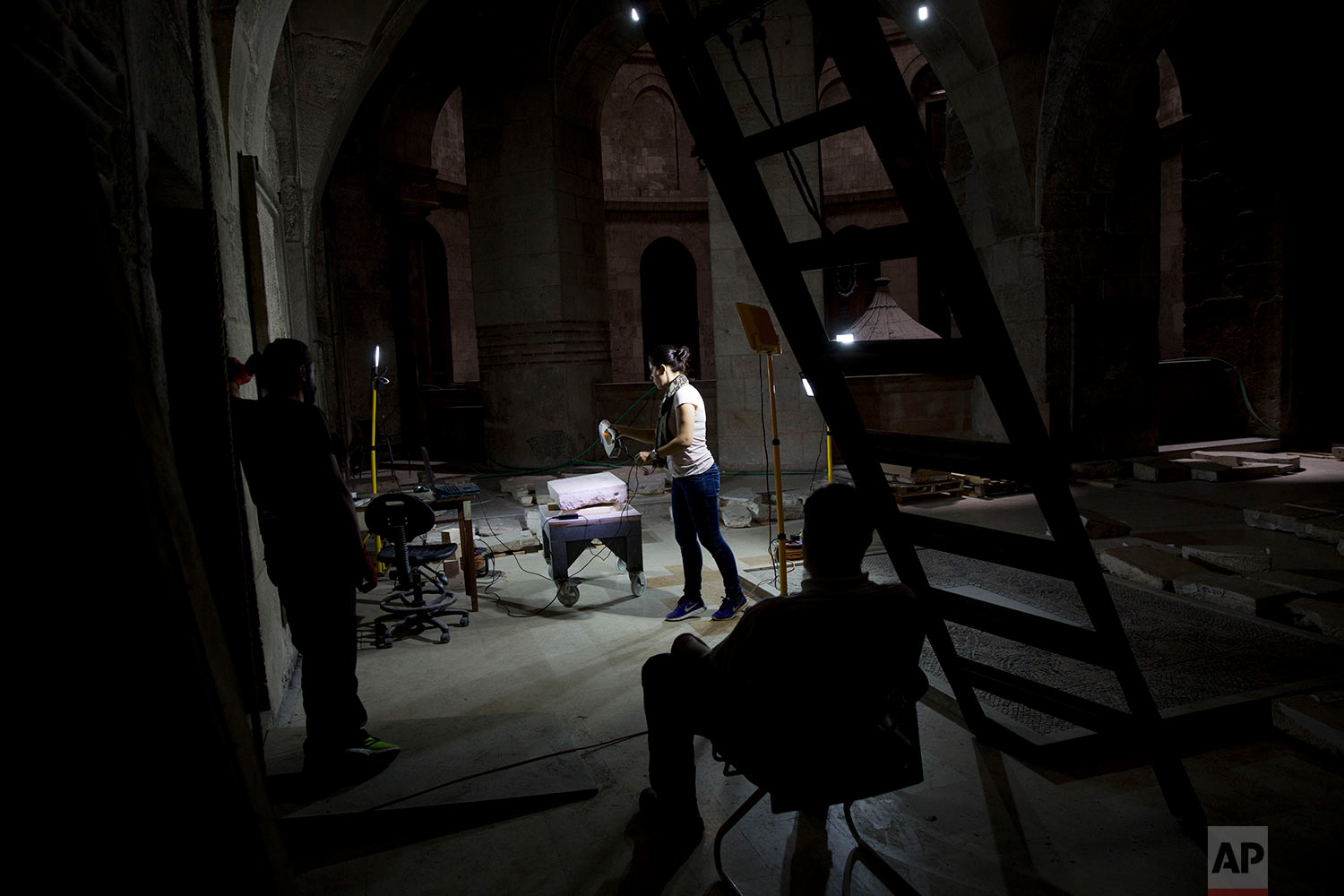 In this Tuesday, Oct. 11, 2016 photo, Elisavet Tsilimantou, member of the conservation team, digitally scans stones before reinstalling them on the façade of the Edicule, the shrine that houses what is believed to be the Tomb of Jesus in the Church of the Holy Sepulchre in Jerusalem's Old City.  (AP Photo/Oded Balilty)