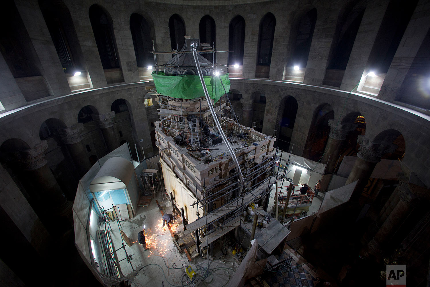 Members of the conservation team remove steel girders supporting the Edicule during restoration work, at the Church of the Holy Sepulchre in Jerusalem's Old City Wednesday, Feb. 22, 2017. (AP Photo/Oded Balilty)