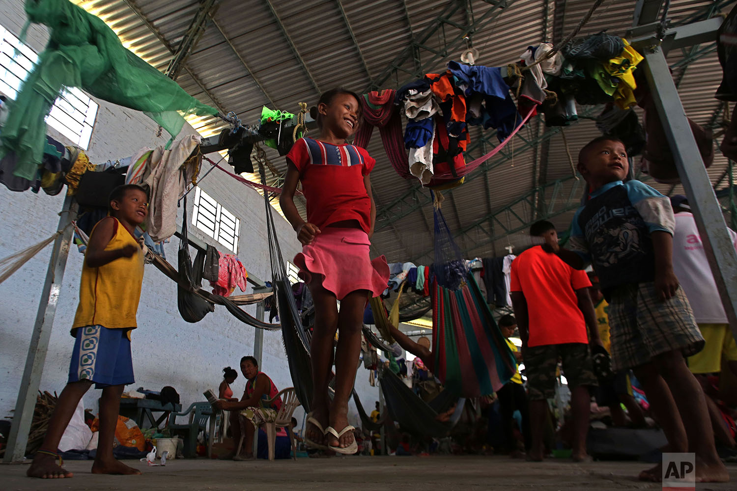 In this March 10, 2018 photo, Warao children from Venezuela play in a shelter, in Pacaraima, Brazil. (AP Photo/Eraldo Peres)