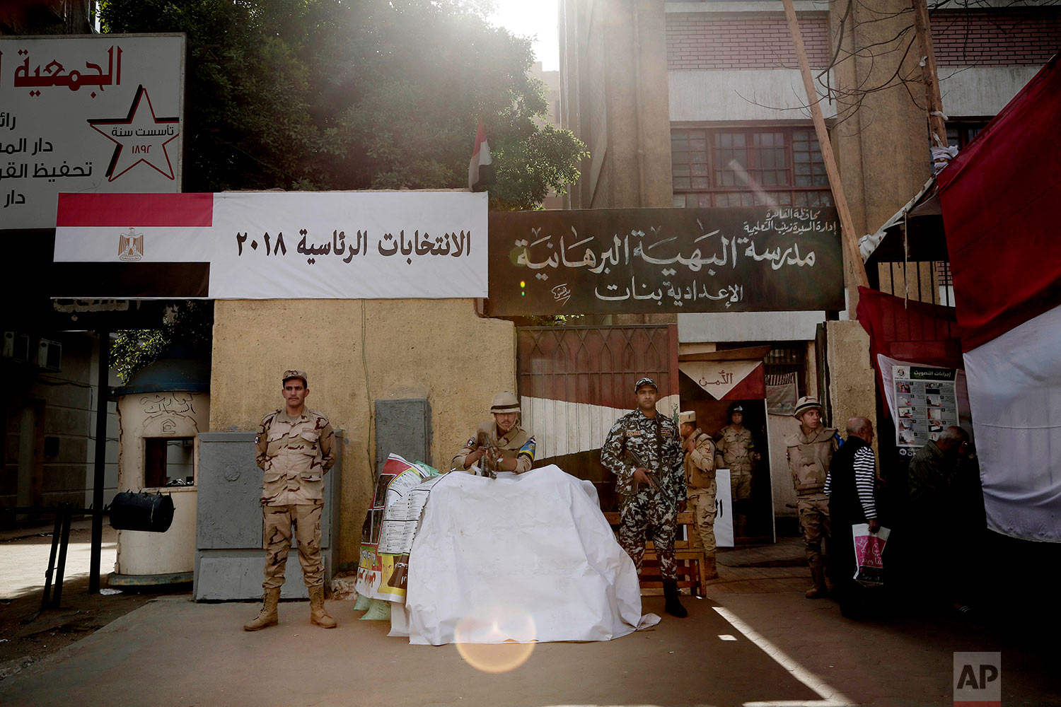 Egyptian military soldiers stand guard during the first day of the presidential election in front of a polling station in Cairo, Egypt, Monday, March 26, 2018. Egyptians head to the polls on Monday but the presidential election this time is not about who wins — that was settled long ago — but about how many people bother to cast ballots. (AP Photo/Nariman El-Mofty)