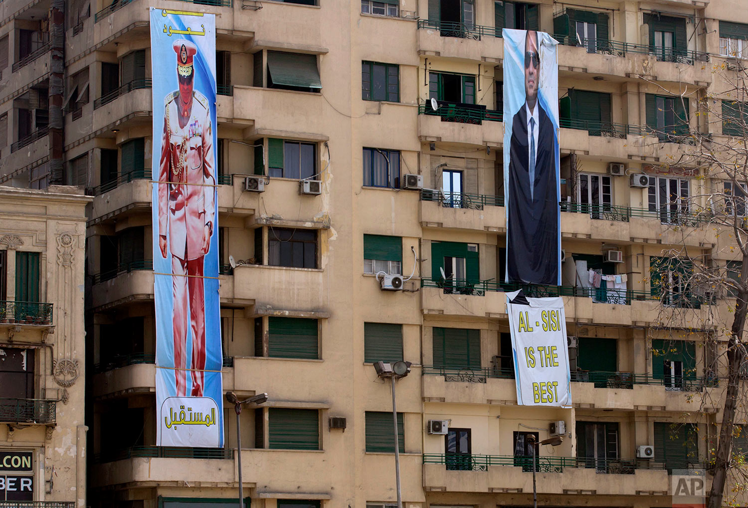 In this Thursday, March 22, 2018 photo, election banners for Egyptian President Abdel-Fattah el-Sissi, hang in Tahrir Square, which was the focal point of the Jan. 25, 2011 Egyptian uprising, in Cairo, Egypt. Seven years ago, Cairo's Tahrir Square was filled with tens of thousands of Egyptians demanding change. Now it is festooned with portraits of the president, vowing continuity. Almost all traces of the popular revolt that overthrew autocrat Hosni Mubarak in 2011 are now gone. (AP Photo/Amr Nabil)
