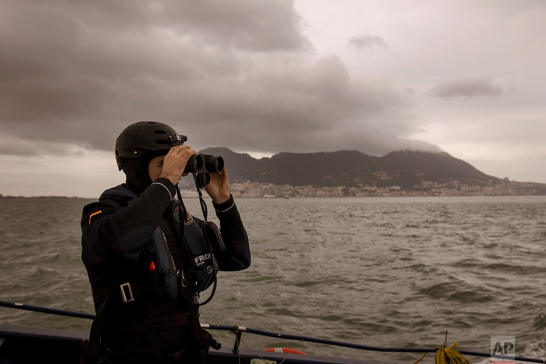 Spanish customs agents look for speedboats carrying cannabis resin. (AP Photo/Emilio Morenatti)