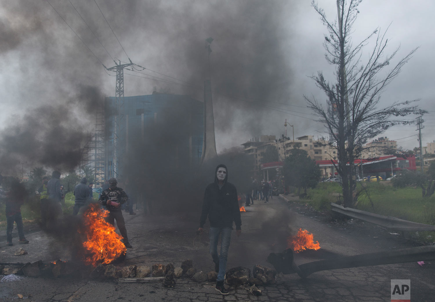 Palestinian protesters clash with Israeli troops following a protest to mark the Land Day in the West Bank city of Ramallah, Friday, March 30, 2018. (AP Photo/Nasser Nasser)