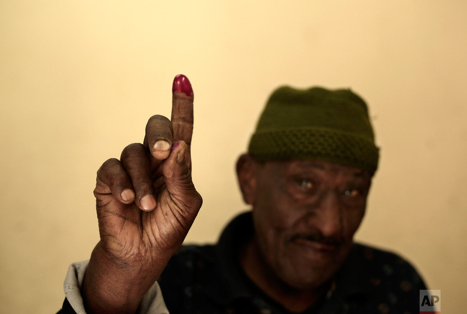 A man shows his inked finger after voting during the first day of the presidential election inside a polling station in Cairo, Egypt, Monday, March 26, 2018. (AP Photo/Nariman El-Mofty)