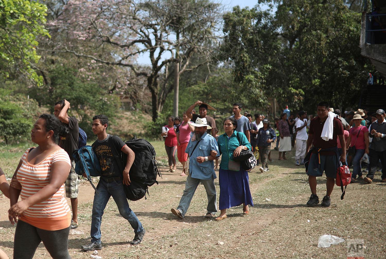 Central American migrants arrive to a sports center in Matias Romero, Oaxaca state, Mexico, Monday, April 2, 2018. (AP Photo/Felix Marquez)