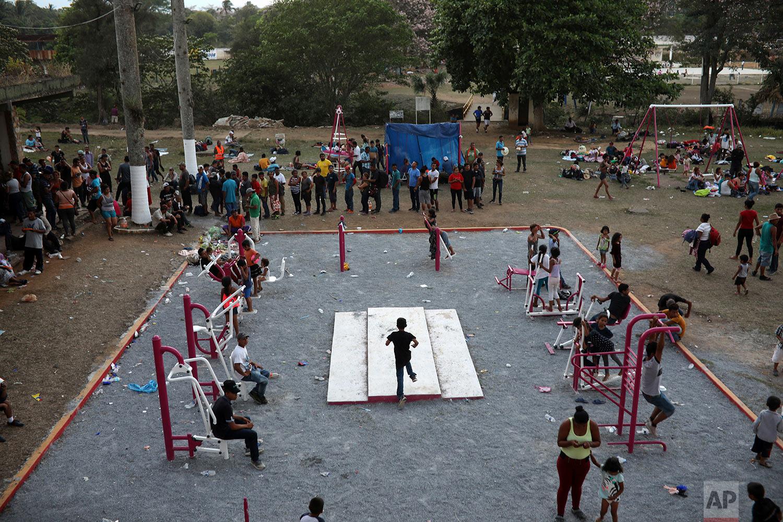 Central American migrants at a sports center in Matias Romero, Oaxaca state, Mexico, late Monday, April 2, 2018. (AP Photo/Felix Marquez)