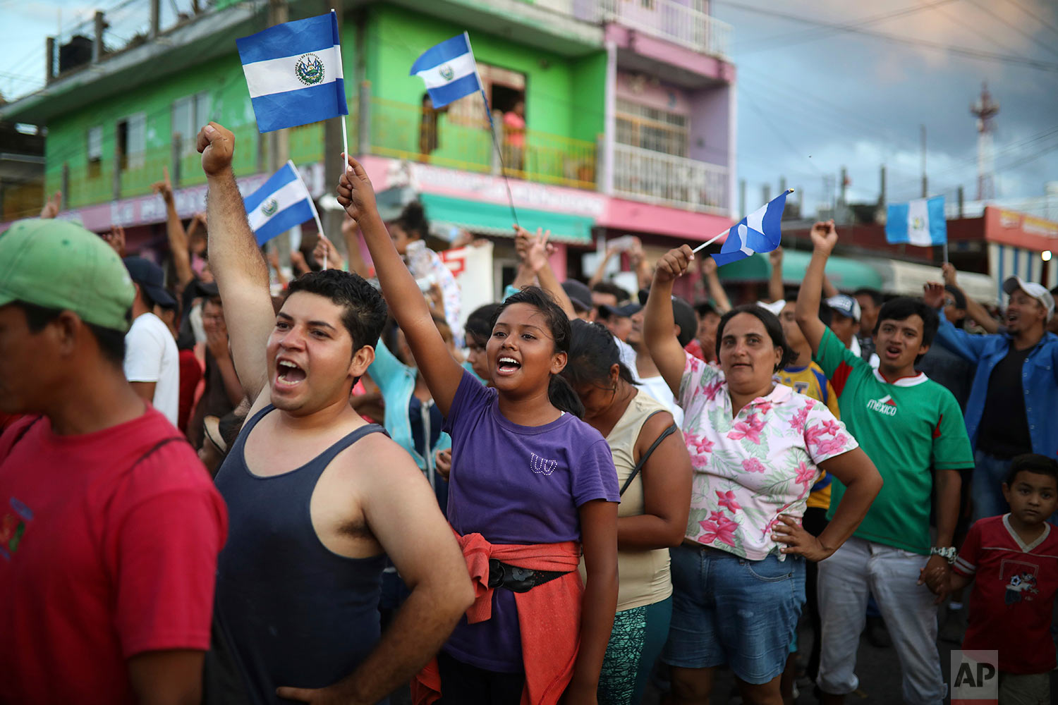 Central American migrants traveling with the annual Stations of the Cross caravan march to call for migrants' rights and protest the policies of U.S. President Donald Trump and Honduran President Juan Orlando Hernandez, in Matias Romero, Oaxaca State, Mexico, Tuesday, April 3, 2018. (AP Photo/Felix Marquez)
