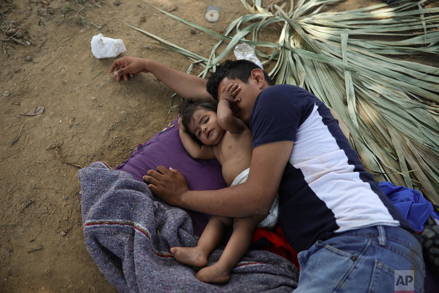 Central American migrants rest during the annual Migrant Stations of the Cross caravan at a sports center during the group's stop in Matias Romero, Oaxaca state, Mexico, Monday, April 2, 2018. (AP Photo/Felix Marquez)