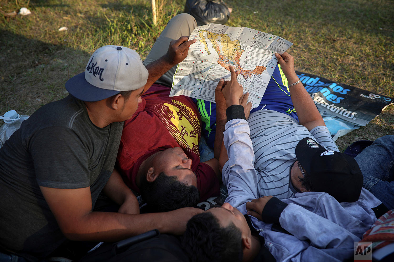 Men study a map of Mexico in Matias Romero, Oaxaca State, Mexico, Wednesday, April 4, 2018. (AP Photo/Felix Marquez)
