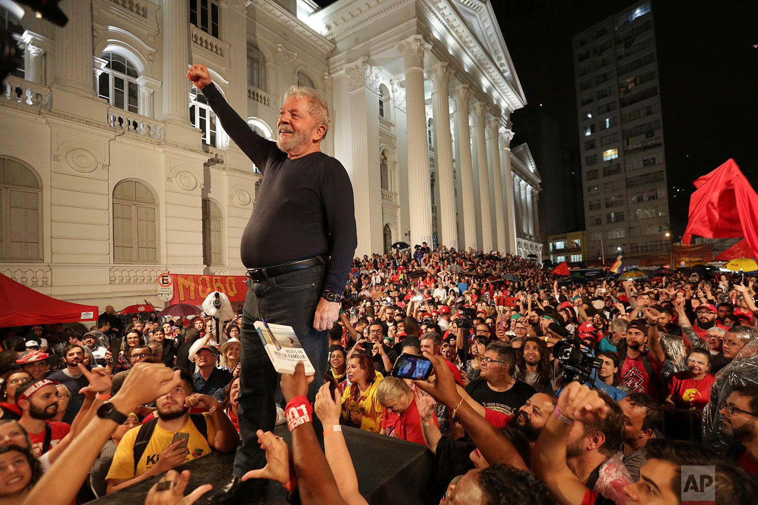 Brazil's former President Luiz Inacio Lula da Silva stands amid supporters during the final rally of his week-long campaign tour of southern Brazil, in Curitiba, Parana state, Brazil, March 28, 2018. Da Silva defended his record and denounced protests against him as the work of fascists, a day after an attack on his campaign caravan exposed the deep divisions ahead of heated elections. (AP Photo/Eraldo Peres)