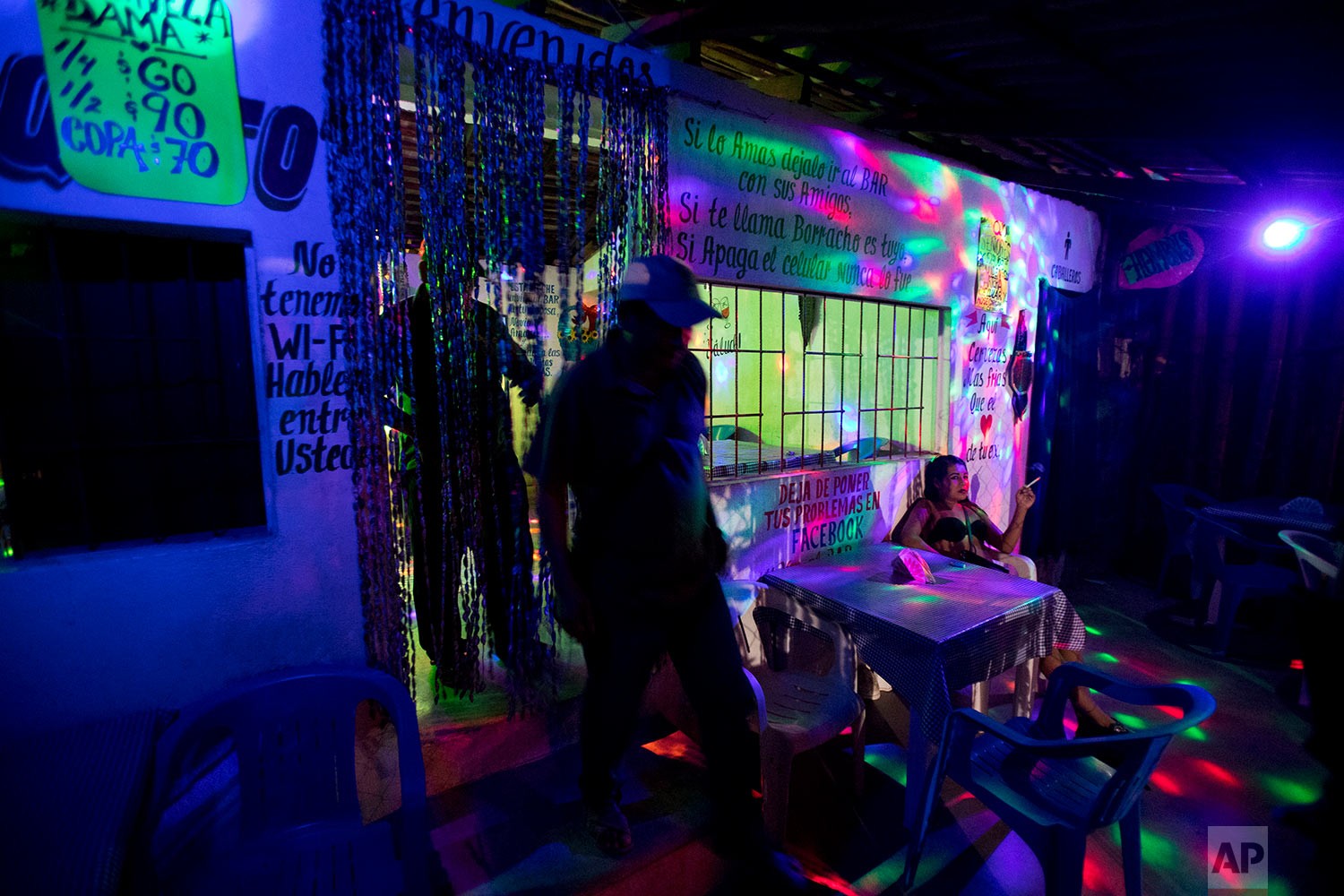 "In this photo published in March, ""community police"" vigilantes inspect a bar in Ayutla de los Libres, Guerrero state, Mexico, Feb. 4, 2018. For these citizen cops, being on duty can mean manning an impromptu road roadblock to search vehicles for contraband, monitoring bars for any nefarious activity or watching over rudimentary police stations with jail cells. (AP Photo/Rebecca Blackwell)"